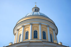 The main dome of Trinity Cathedral of Alexander Nevsky Lavra close up, against the background of the blue sky. St. Petersburg Stock Photography