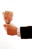 Main donnant l'argent Photographie stock libre de droits