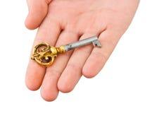 Main donnant la clé Photo libre de droits