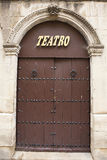 Main door with decorated arch of the theater of Ubeda Stock Photography