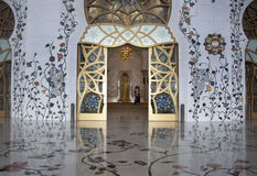 Main door and floral floor. Main door and floral florring of Sheikh Zayed Mosque in Abu Dhabi royalty free stock photo