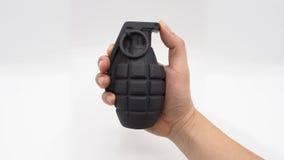 Main droite d'homme et bombe militaire Image libre de droits