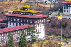Close up of corner tower of Tashichho Dzong with bhutanese flag stock photos