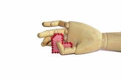 Main en bois avec le coeur Photos libres de droits