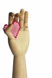 Main en bois avec le coeur Image libre de droits