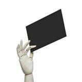 Main en bois blanche tenant la page noire photos stock