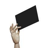 Main en bois tenant la page noire images libres de droits