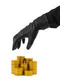 Main en gant et argent Photographie stock