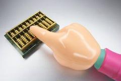 Main en plastique avec l'abaque miniature Photos libres de droits