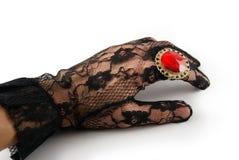 Main enfilée de gants Images stock