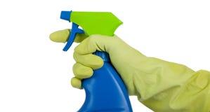 Main enfilée de gants avec la bouteille de jet Photographie stock libre de droits