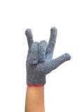 Main enfilée de gants de travailleur avec le doigt pour le symbole d'amour Photo stock