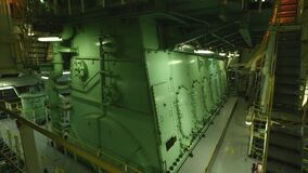 Main engine in engine room of large vessel. stock footage