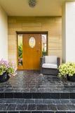 Main entrance with big wooden doors. Elegant dark path leading to the main entrance with big wooden doors Royalty Free Stock Photos