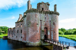 Main entrance of Caerlaverock Castle, Scotland. Triangular shaped castle with water filled moat originally built in 13th century Stock Photo