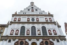 Main entrance door of Saint Michael Christ Church at day time in Munich, Germany stock photo