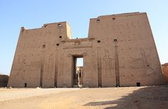 The main entrance of Edfu Temple showing the first pylon. Egypt. Royalty Free Stock Image
