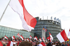 Main entrance at European Parliament with crowd protesting Royalty Free Stock Photography