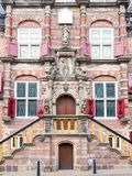 Front detail of town hall in Bolsward, Friesland, Netherlands. Main entrance and front facade of town hall in historic old town of Bolsward, Friesland Royalty Free Stock Photos