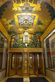 Main entrance in the house on Fifth Avenue. Christmas decorated main entrance in the house on Fifth Avenue. gold and green architectural elements in the French Royalty Free Stock Image