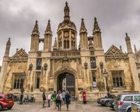 Main entrance of King`s College in a cloudy day. stock photos