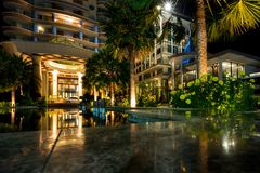 Main entrance of Long Beach Garden Hotel and Spa at nigh Royalty Free Stock Images