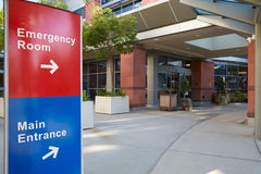 Main Entrance Of Modern Hospital Building With Signs Stock Photos