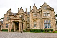 Main entrance at Muckross House, Killarney, Ireland. Muckross House, County Kerry, Ireland - a Tudor style mansion built in 1843 located on the small Muckross Stock Photos