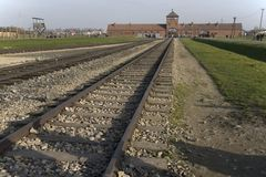 Main entrance and rails of the former death camp Auschwitz-Birkenau Royalty Free Stock Photos
