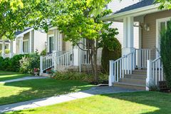Main entrance of residential houses with lawn in front. On bright sunny summer day stock photos