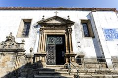 Braganca Sao Vicente Church. Main entrance of the Sao Vicente Church with the seventeenth century Mannerist portal, flanked by a water fountain a tiles panel, in Stock Photos