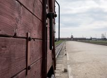 Main entrance to Auschwitz Birkenau Nazi Concentration Camp, showing one of the cattle cars used to bring victims to their death. Auschwitz, Poland. The main Royalty Free Stock Images