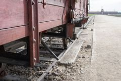 Main entrance to Auschwitz Birkenau Nazi Concentration Camp, showing one of the cattle cars used to bring victims to their death. Auschwitz, Poland. The main Royalty Free Stock Photo