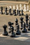 Public chess games in Bastions Park, Geneva. The main entrance to Bastions Park is from Place Neuve. Just behind the big decorated gate are huge black-white Royalty Free Stock Images