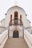 The main entrance to the church in the village of Great Martyr Barbara Varvarovka, a suburb o Stock Photos