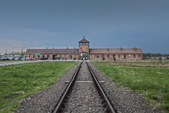 Main entrance to the concentration camp. Barbed wire around a concentration camp. Museum Auschwitz - Birkenau. Holocaust Memorial Museum. Main entrance to the Royalty Free Stock Image