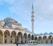 The main entrance to the Suleymaniye Mosque. ISTANBUL, TURKEY - JANUARY 21, 2015: The courtyard of the Suleymaniye Mosque with the view on the main entrance and Stock Photos