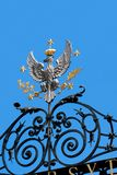 Warsaw university gate. Silver crowned eagle above the University Gate (Warsaw, Poland) with a laurel and palm leaves in its claws. The eagle is surrounded by stock photo