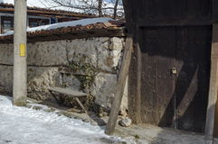 A main entrance in yard of old house with bench, town Koprivshtitsa Royalty Free Stock Photography