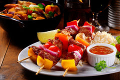 Main Entree Concept - Kebabs on Rice with Sauce Royalty Free Stock Photo