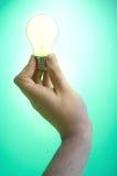 Main et ampoule Images libres de droits