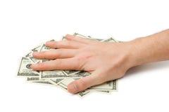 Main et argent Photo stock