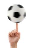 Main et bille de football de rotation Photographie stock