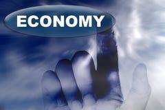Main et bouton avec le mot de l'économie photographie stock libre de droits