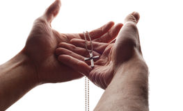 Main et croix photographie stock libre de droits