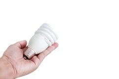Main et lampe fluorescente Photo libre de droits