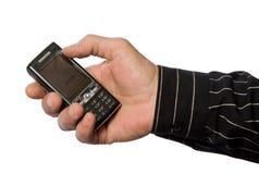 Main et le téléphone Photos stock