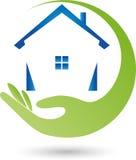 Main et maison, vrai logo d'agent immobilier Photographie stock libre de droits