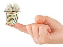 Main et petits livres Photographie stock libre de droits