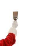 Main et pinceau de Santa image libre de droits